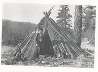 Early Resident beside Cedar Teepe