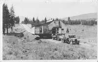 Truck Towing House on Trailer