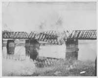 Train bridge at Marcus burning.